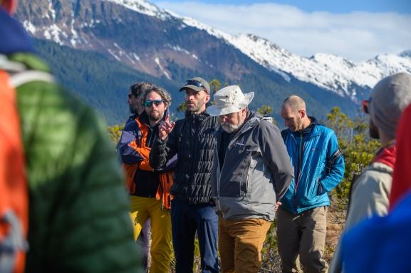 Ian Giesbrecht talks to the group. (L to R: Christian Mohr, Ian Giesbrecht, Paul Sanborn, and Jason Fellman)
