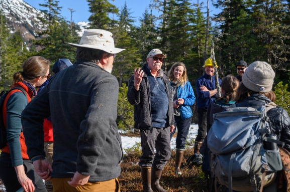 USFS scientist Rick Edwards talks to the group at a poor fen site.