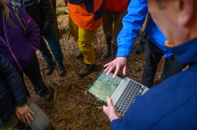 Dave D'Amore shows participants a topographical map of the area.